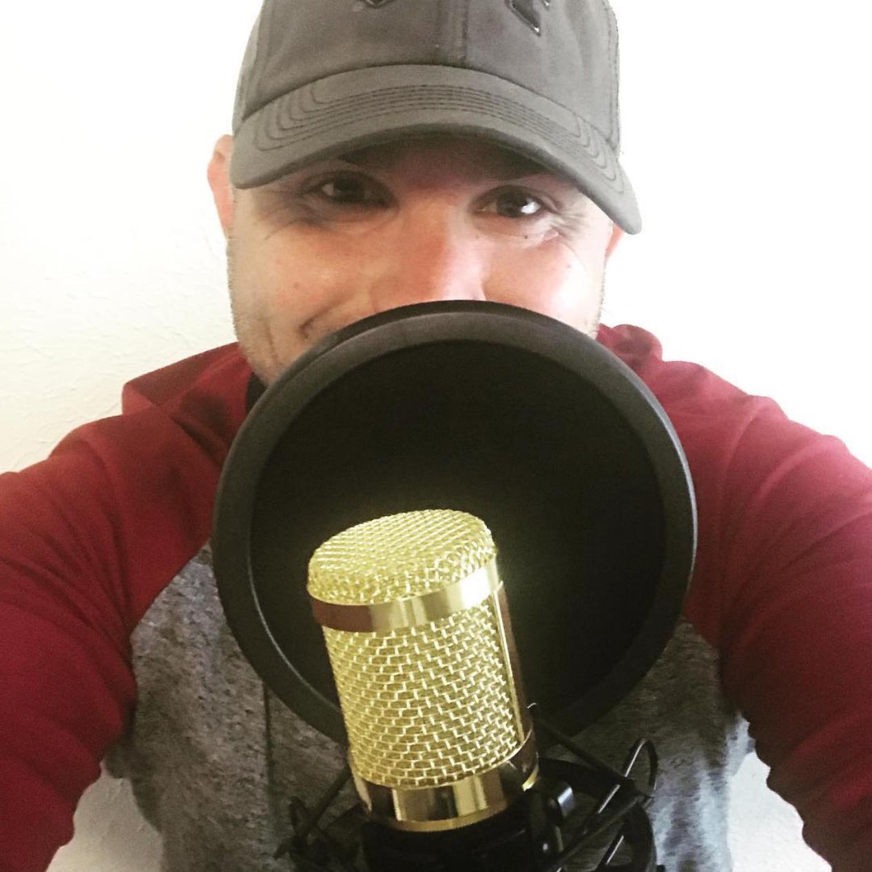 Justin Sliva behind the mic